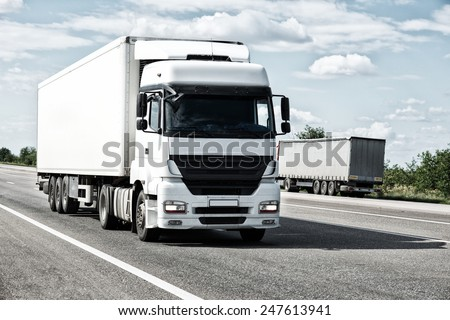 White truck on road. Cargo transportation