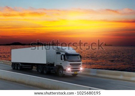 White Truck on road container, transportation concept.,import,export logistic industrial Transporting Land transport on the expressway with sunnset #1025680195