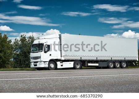 White truck on road with blue sky, cargo transportation concept