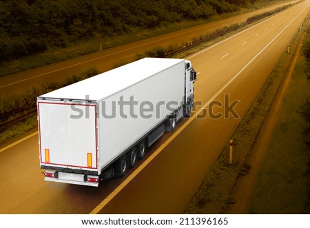White truck on the highway. Picture with space for your text.