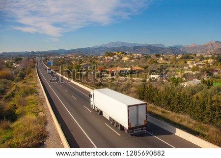 White truck on the road. Top view of the road. Shipping Place for text. Freight transport. Highway. Perspective. Motorway. Mock up.