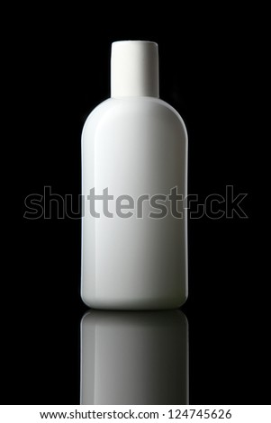 White tube bottle of shampoo, conditioner, hair rinse, mouthwash, on a black background with reflection.