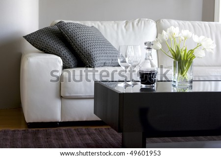 white tulips and red wine in modern living room