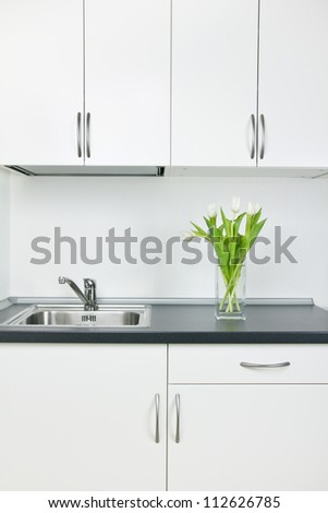 White tulips on kitchen