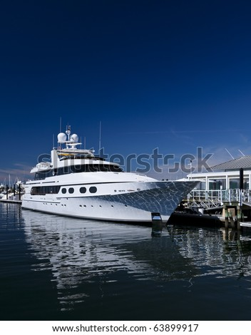 White unmarked luxurious motorboat docked in port stock photo