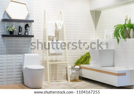 White urinal and washbasin and shower in granite bathroom, Modern house bathroom interior, luxury bathroom - Shutterstock ID 1104167255