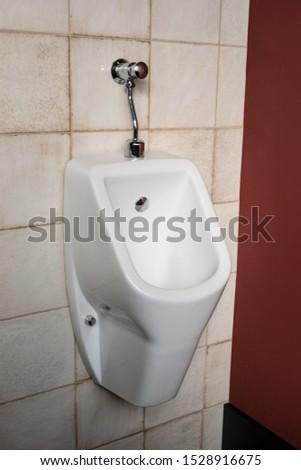 White urinal men in public toilet. Men public toilet concept