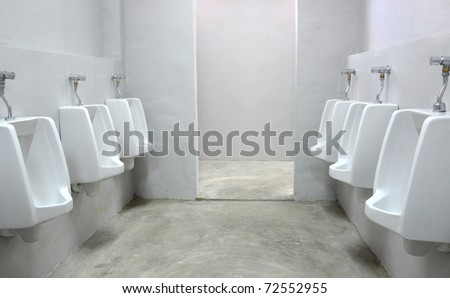 white urinals in bathroom