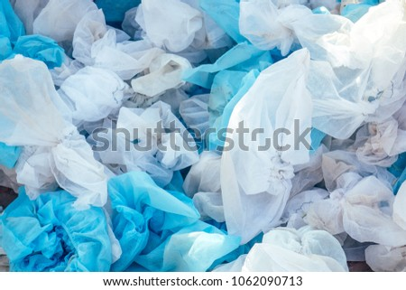 white used medical shoe covers in trash. the concept of hygiene and protection. environmental pollution #1062090713
