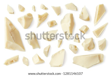 White various broken chocolate pieces isolated on white background. Top view