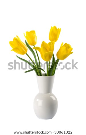 White vase with yellow tulips isolated over white