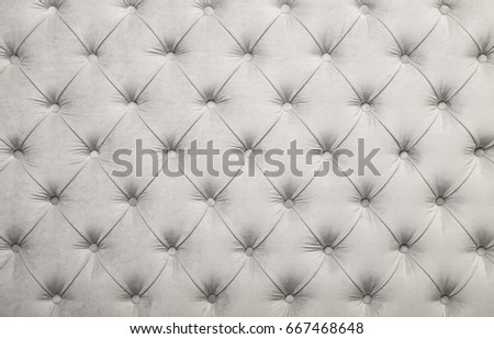 White velvet capitone textile background, retro Chesterfield style checkered soft tufted fabric furniture diamond pattern decoration with buttons, close up #667468648