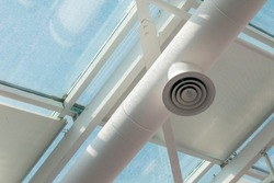 White ventilation pipe on the polycarbonate transparent ceiling. Copy space.