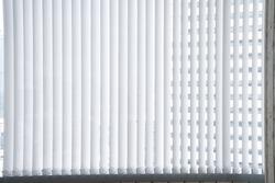 White vertical blind, Modern sun blinds for office, Stripe curtain for the office room decoration.