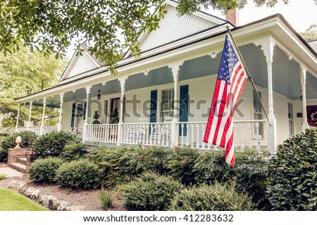 White Victorian Home with American Flag