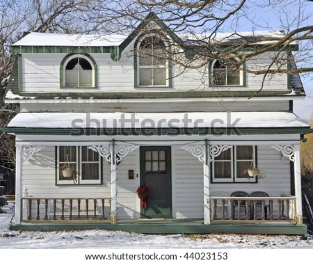 White victorian style home with ornate gingerbread trim for Gingerbread trim for houses