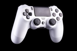 White video game joystick gamepad isolated on a black background with clipping path