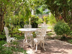 white vintage bistro table chair set in garden
