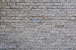 White vintage Bumpy, rough and old brick texture of lightweight concrete with English brick bond pattern.