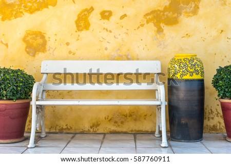 white vintage garden bench in...