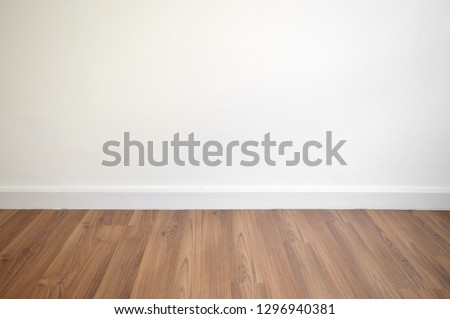 white wall and brown wood floor #1296940381