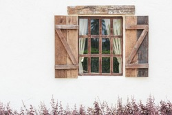 white wall and old wood window