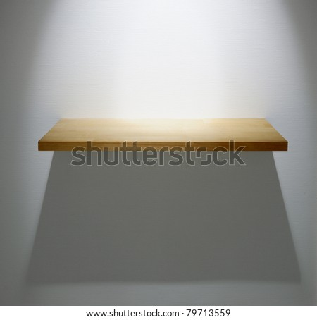 White wall and wooden shelf for exhibit