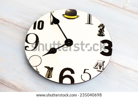 white wall clock with black number