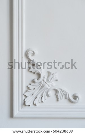 white wall molding with...