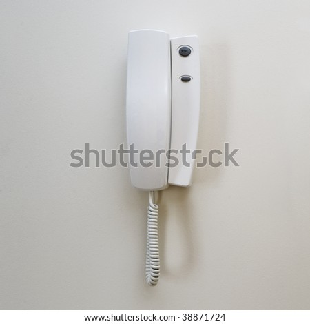 white wall mounted contemporary entry phone system - stock photo