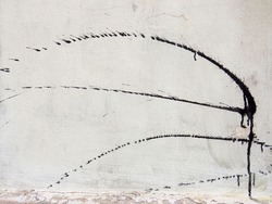 White wall texture with black paint brush strokes. Grunge background. Full frame.
