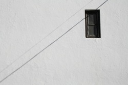White wall will little window and crossing line shadow, minimal architecture