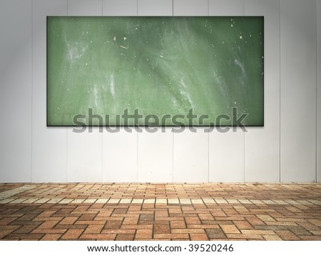 white wall with grungy blackboard.
