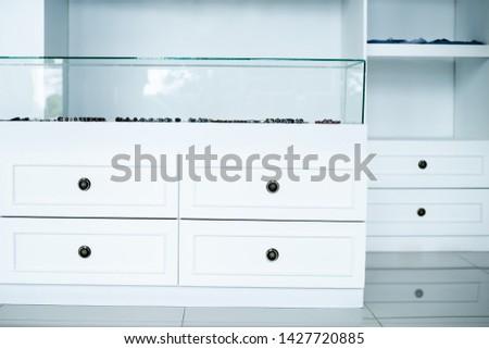 white wardrobe chest of drawers, interior dressing room, store.