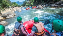 white water rafting with a team of green helmets in Thailand
