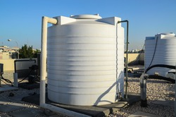 White water tanks of industrial building on roof top or deck
