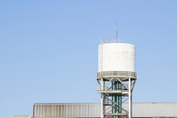 White water tower or water tank and blue sky