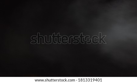 White water vapour on a black background. Close-up shot 4k. Realistic Atmospheric Gray Smoke on Black Background. White Fume Slowly Floating Rises Up. Abstract Haze Cloud. Animation Mist Effect. Smoke stock photo