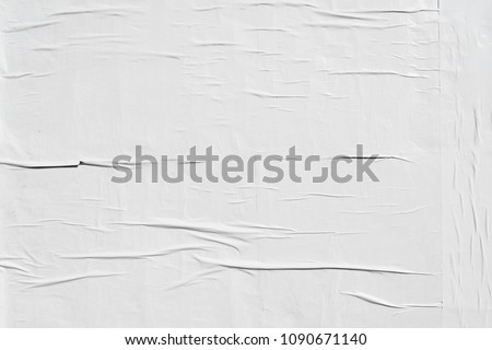 white weathered glued advertising poster