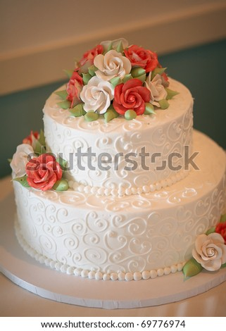 stock photo White wedding cake with orange and green flowers