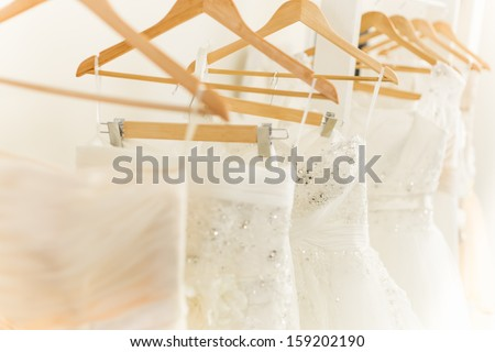 White Wedding Dresses in dress store.