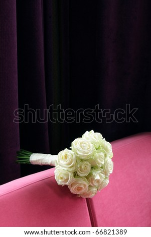 stock photo White wedding flowers on purple bench