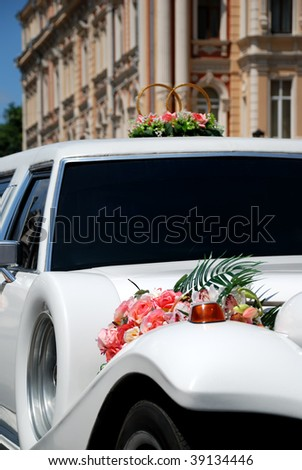 White wedding limousine decorated with flowers