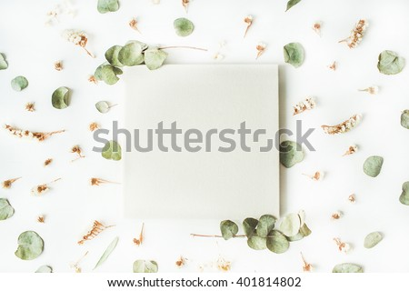 white wedding or family photo album, dry and fresh branches isolated on white background. flat lay, overhead view