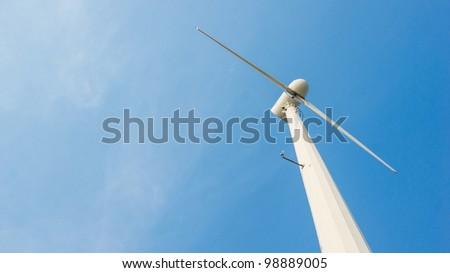 white wind turbine electricity on blue sky