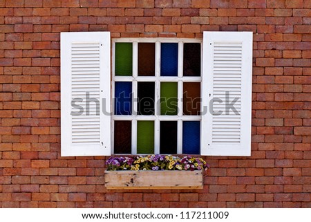 White window colorful glass on brick wall  of vintage house style