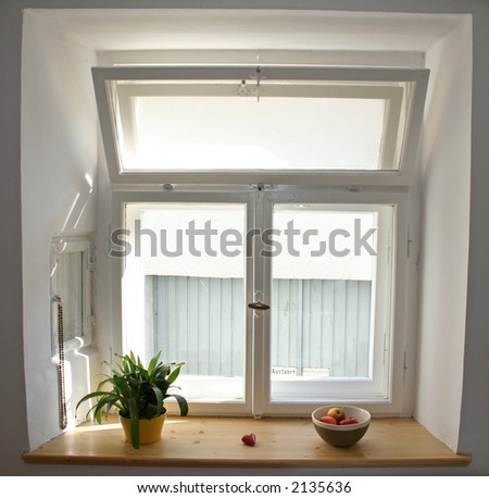 white windows with apples and plant