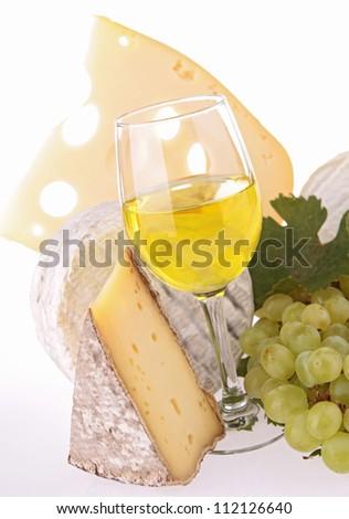 white wine and assortment of cheese - stock photo
