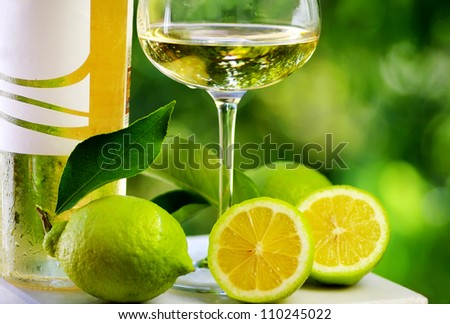 White wine and green lemons.