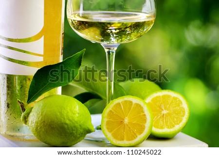 White wine and green lemons.
